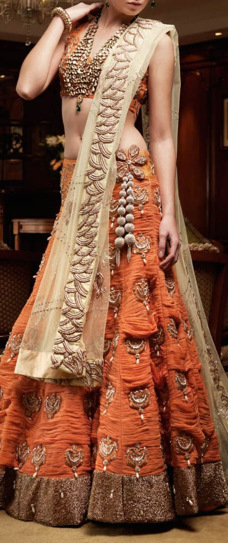 Love the orange color on this choli - even better if you have a long torso to show off! Great idea for a sangeet outfit or another indian wedding event