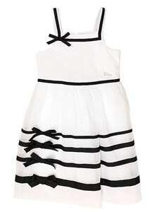 Baby Dior Kids girls white nautical prom style dress Simply stunning white girls dress from Dior Kids. Made from layers of fine cotton batiste adding lustre to the dress. Netting is used under the top layer to add volume to the bottom half of the dress. Black ribbon around neckline and waist. Four rows of black ribbon run around the lower skirt of the dress featuring four bows at the front which gives the dress a nautical feel. Dior silver and diamante charm sits just above the waistline.