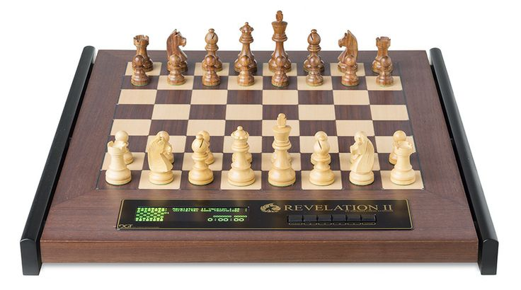 Large wood chess set that plays you. probably the most remarkable chess playing gadget the world's ever seen. many software programs built in. it does so much.  Chess against computer.