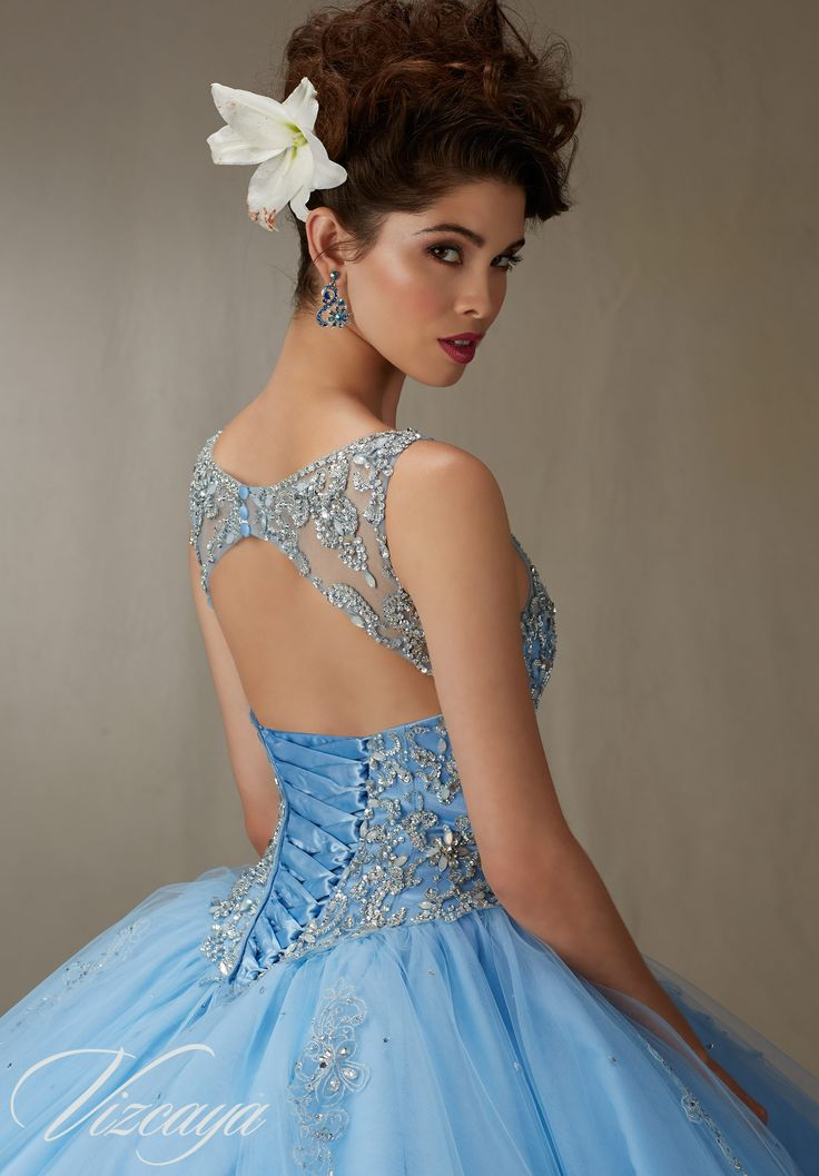 Matching Stole included. Colors available: Bahama Blue, Blush, Champagne and White. Quinceanera Dresses and 15 Dresses by Designer Madeline Gardner.
