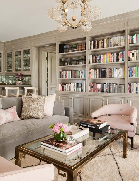 library bookshelf decorating ideas taupe and pink color palette with beni ourain rug - Bookshelves Living Room