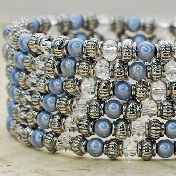 Shimmering and shining, this gorgeous gray and clear bracelet is enchanting like the mysterious Marfa lights on the horizon. Silver miracle beads