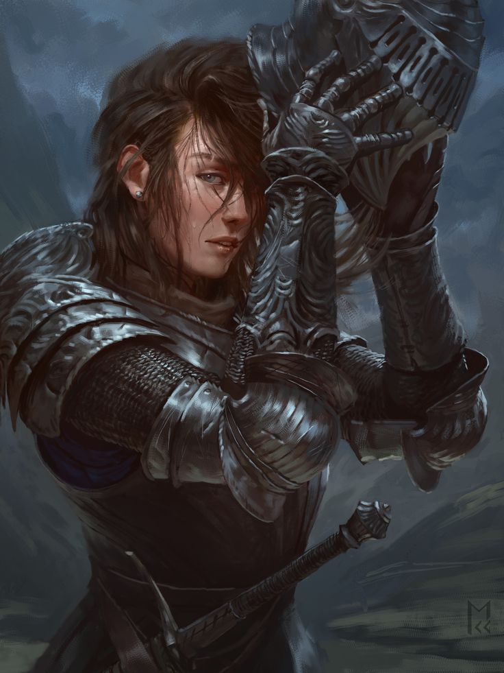 A lady in shining armor removing her helm after a long ride or a hard day at work