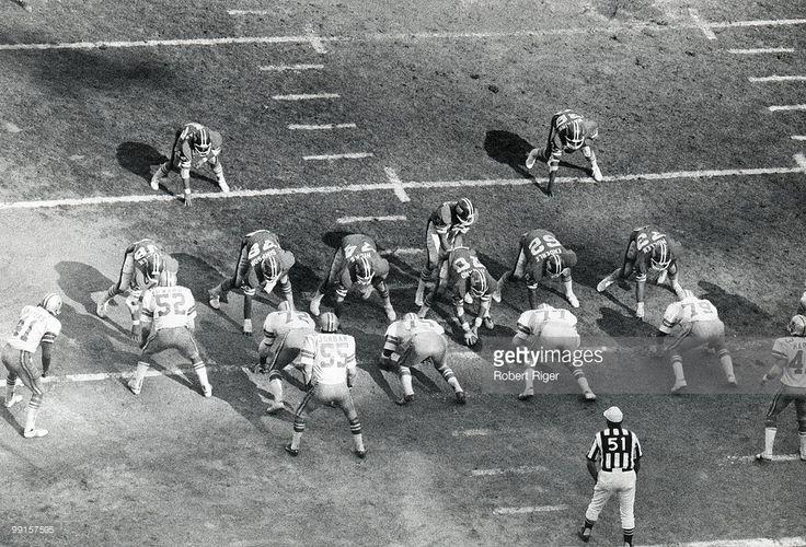 Overhead view of Dallas Cowboys game against the New York Giants at Shea Stadium on October 12, 1975 in Flushing, New York. Giants players include Bob Tucker #38, Doug Kotar #44, Al Simpson #79, John Hicks #74, Craig Morton #15, Bob Hyland #70, Dick Enderle #62, Larry Watkins #36 and Tom Mullen #73. Cowboys players include Charlie Waters #41, Dave Edwards #52, Ed (Too Tall) Jones #72, Lee Roy Jordan #55, Jethro Pugh #75, Bill Gregory #77 and Harvey Martin #79.