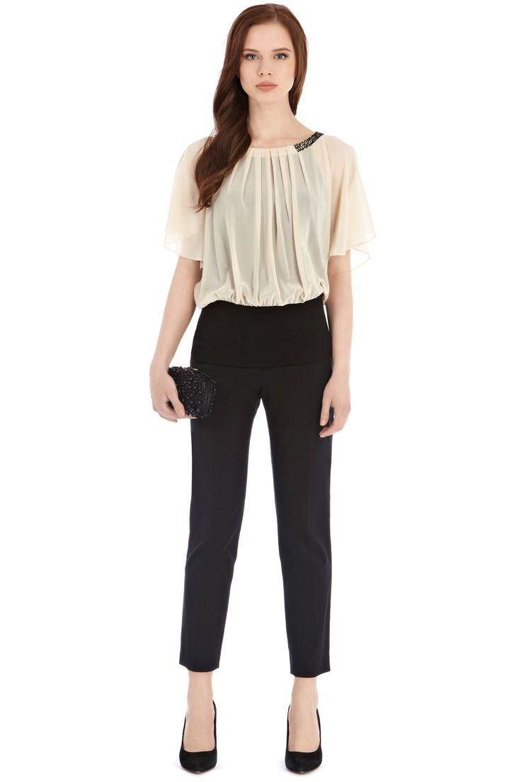 A gorgeous sheer top with floaty winged sleeves and pleat detail for a feminine appeal. The collar of the gorgeous Danielle Calla Top is embellished with sparkling black beads for a refined finish. The top has a wide stretchy waistband for ultimate day to night comfort. The top is lined with a camisole for a demure look.