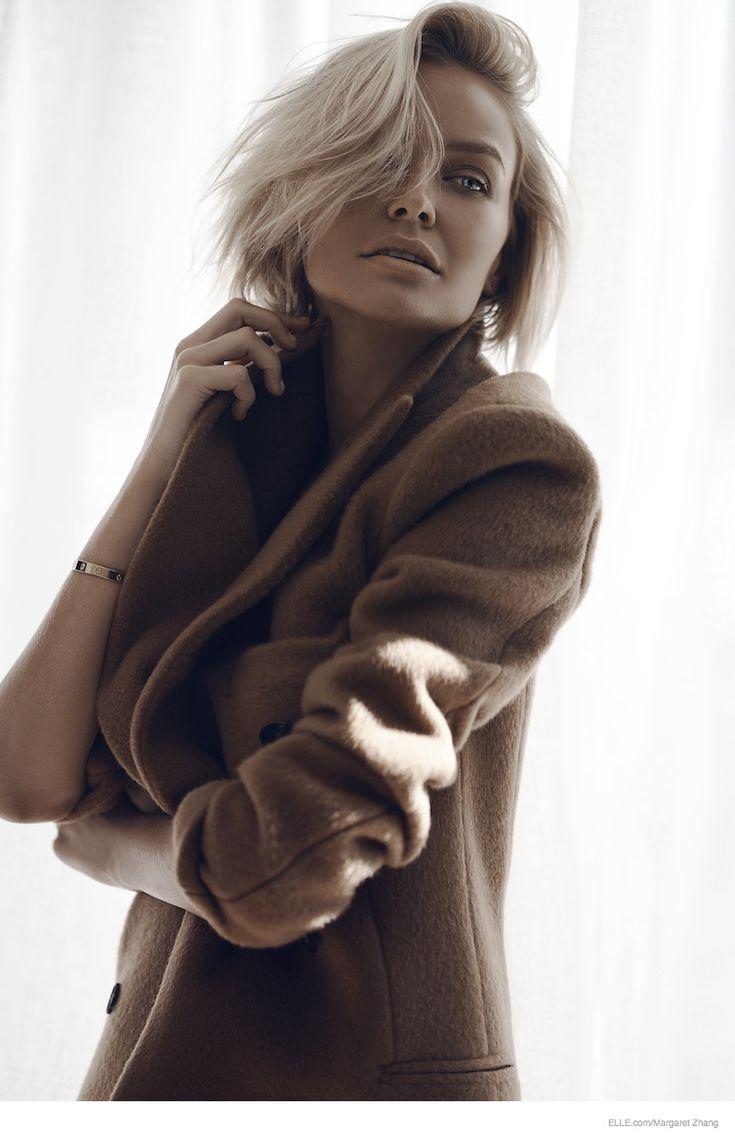 Lara Goes Neutral--Australian socialite and model Lara Bingle takes the spotlight for this online feature for Elle.com. Wearing neutral tones, Lara poses f
