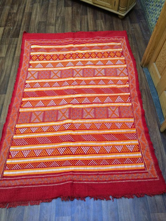Nomad Tribal Embroidered Kilim This is a woolen rug made from simple weaving techniques. The patterns on the rug are traditional and tribal