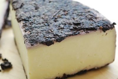 Testun al Barolo cheese, from Piedmont region of italy, is made with the residue of Nebbiolo grapes... simply amazing