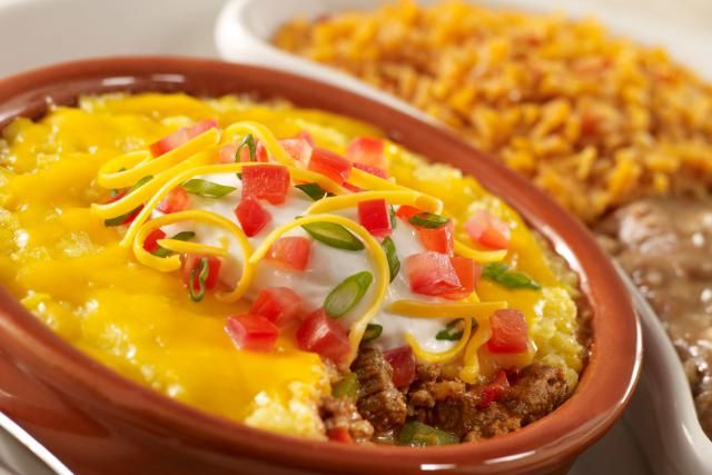 The savory ground beef filling in this tamale pie includes corn and tomatoes, and the crust gets extra flavor from chopped ripe olives.