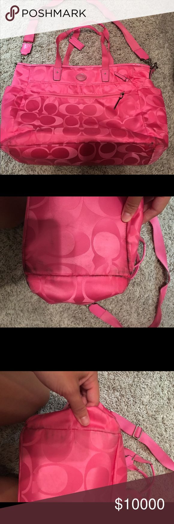 Pink coach diaper bag This bag is in great condition. Authentic pink coach diaper bag. There are the marks on the bag, on the bottom and a little bit of a split on the handles but still in really good condition. Coach Bags Baby Bags