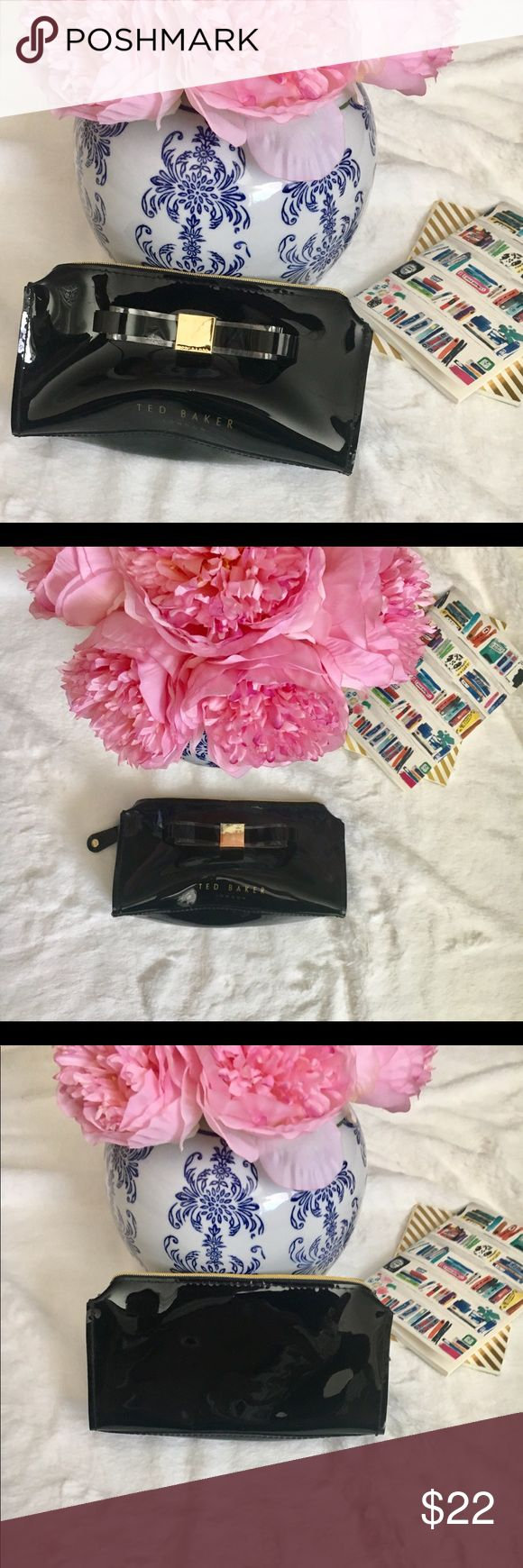 NWOT Ted Baker PV Cosmetic Bag Black shiny cosmetic bag. Classic ted baker bow makes this bag extra cute! No wear on inside and in great condition! W 7.25 in. H 4 in. D 2 in.   No trades Ted Baker London Bags Cosmetic Bags & Cases