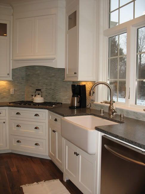 Corner stove top....Love it!  This might be the prefect layout for our kitchen. Notice dishwasher to the right of sink.