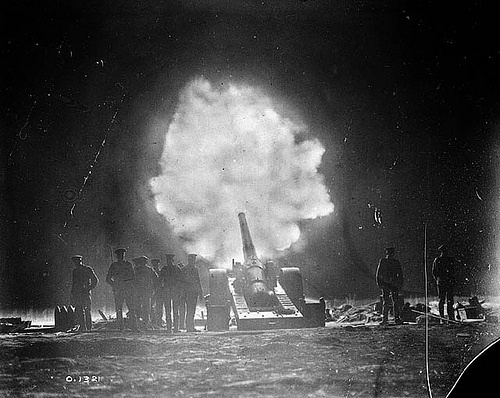 Naval gun firing over Vimy Ridge behind Canadian lines at night. May, 1917.