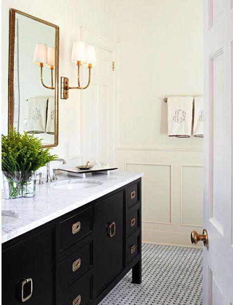 Marble countertop, monogram towels, pop of green  #bathroom