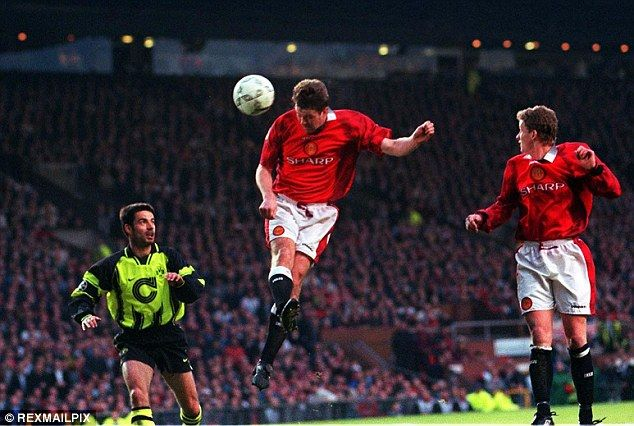 Gary Pallister gets his head on the ball during United's 1997 Champions League semi-final ...
