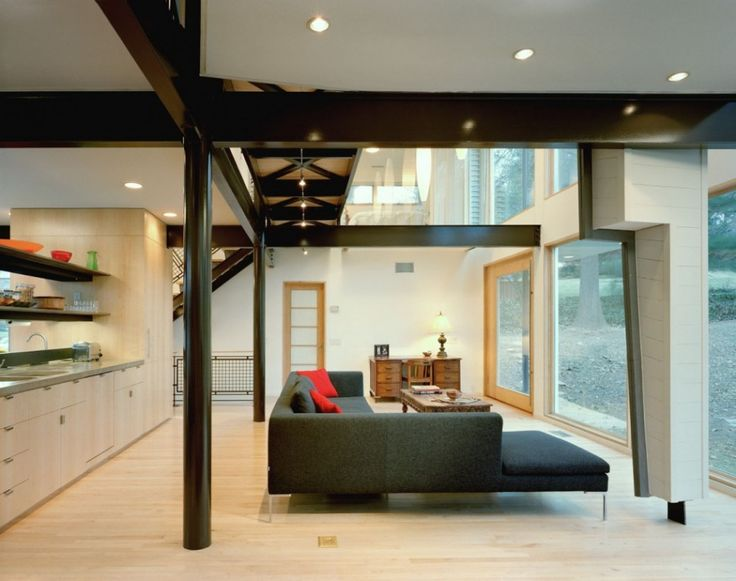 Interior Reasons Why Japanese Interior Design is Popular: Awesome Modern Decoration Ideas Appliances Living Room Architecture Furniture With Black L Shaped Sofa Modern Luxurious Also Red Cushion And Wooden Coffee Table And Bay Window Also Laminated Flooring