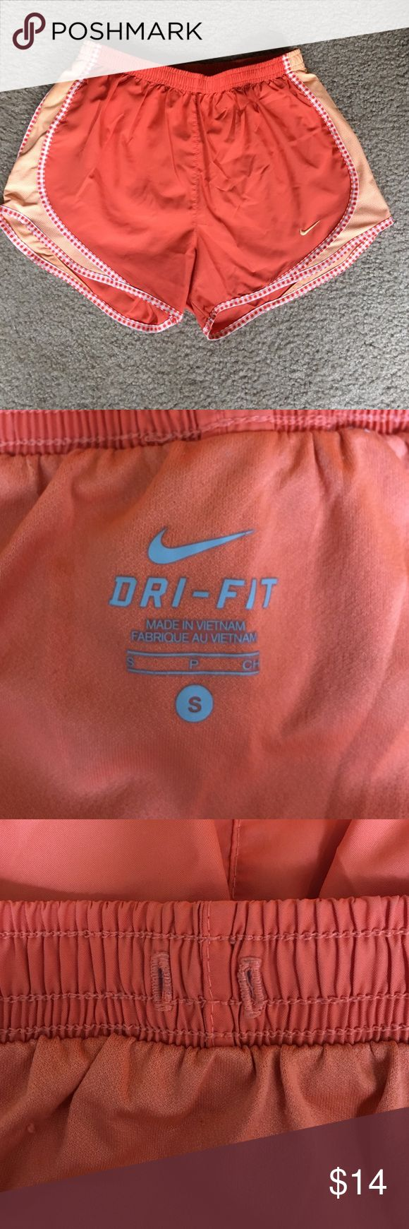 Orange Nike dry fit shorts Orange Nike dry fit shorts size small. String has been pulled out. Nike Shorts