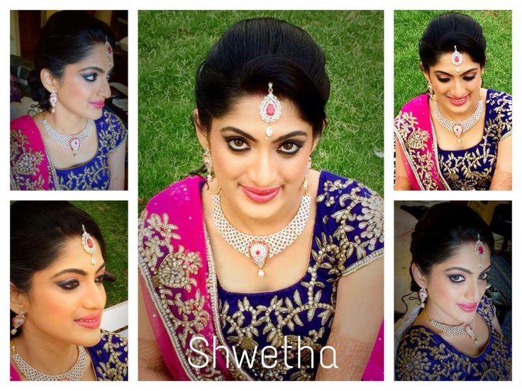 Indian bride wearing bridal hair, lehenga and jewellery. Muhurat look. Makeup by Swank Studio. Find us at https://www.facebook.com/SwankStudioBangalore