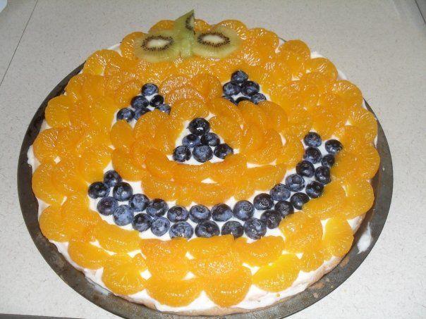 Halloween fruit pizza!  I used kiwi, mandarin oranges, and blueberries!
