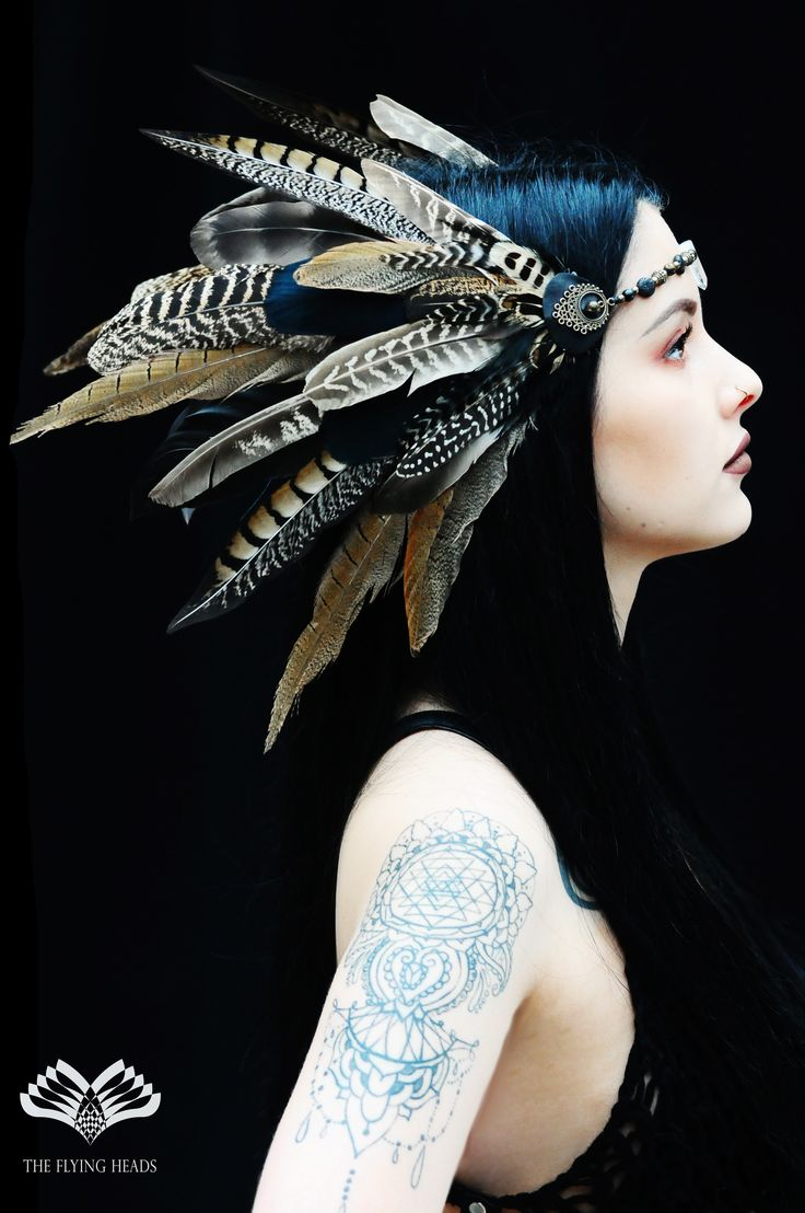 *** The Flying Heads Dark Fairy Headband *** This unique feather headdress creation turns You into the Dark Fairy of the deep, dusky woods.  You can find the clearquartz, leader of all healing crystals placed in the middle at the forehead, followed by hawkeye crystalbeads, tuff stones and brassbeads. The beautiful symmetrical feather arrangements are made of rooster, pheasant, guinea fowl and peacock feathers.