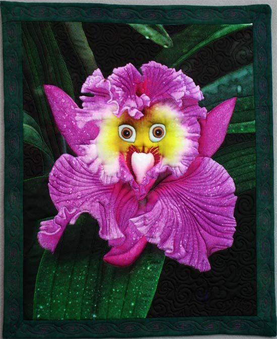 A Whimsical orchid flower with a parrot's eyes is the subject of an art quilt by Barbara Barrick McKie
