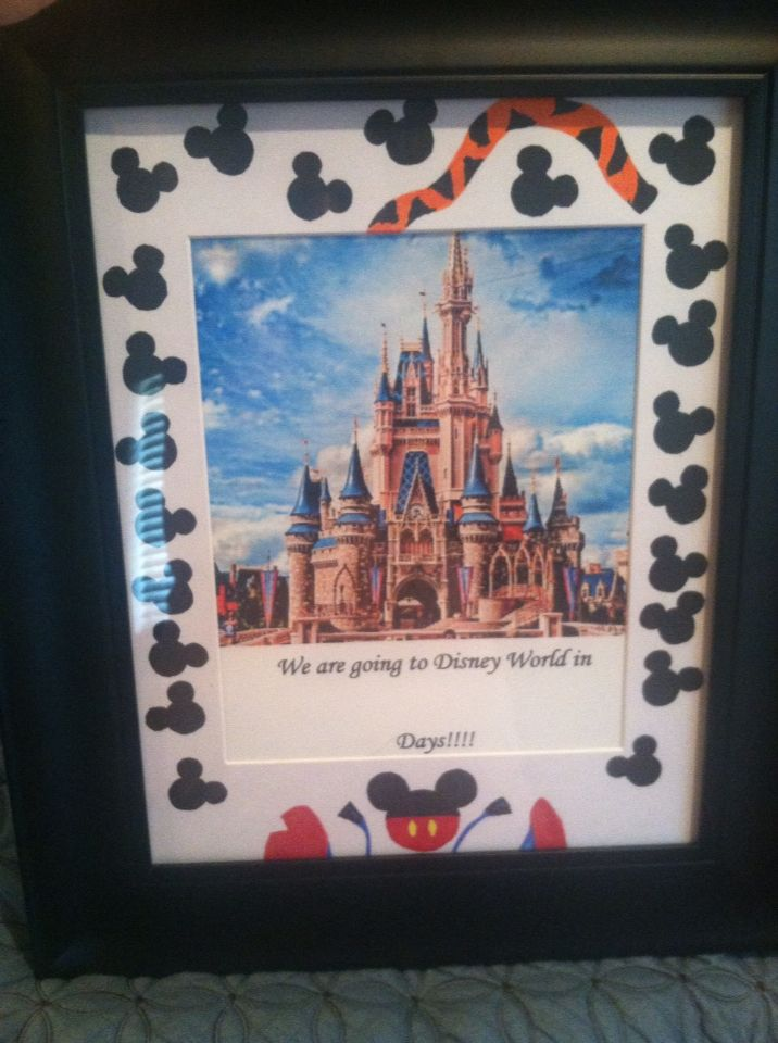"Used a normal pic frame to announce to our boys we are going to Disney. Framed a pic of the castle with ""we are going to disney world in ...... Days"". Will use a dry erase marker to put the numbers on the glass. Then I drew some Mickey Mouse ears around on the matting. To make up for the total lack of evenness, I added stitch at the bottom and tigger at the top. When we return I will put a family pic in the frame to replace the count down. We will wrap this for Christmas."