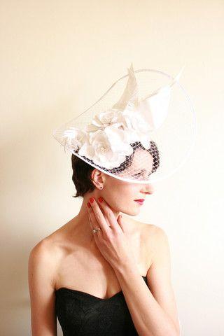 Gala En Blanco (White), stunning silk floral arrangment on a veiled base.
