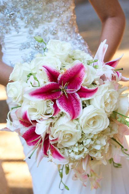 CD Florals: Cascading bouquet made of white Hydrangea, white Rose, Stargazer Lily and blush pink Dendrobium Orchids. Photo: Hidden Kiss Studio