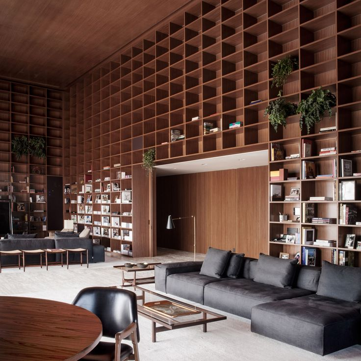 Studio MK27 creates giant shelving units in São Paulo penthouse