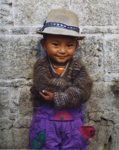 My favorite picture of a child from Ecuador. What a precious little man! He does, he looks just like a little tiny man! :-)