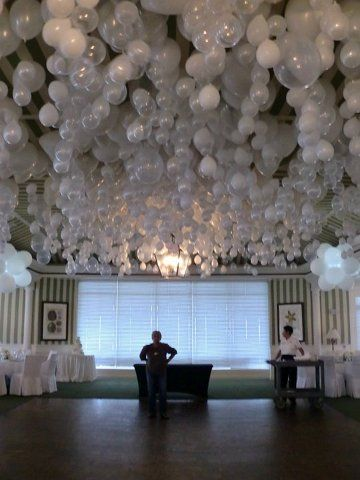 Awesome idea. Helium balloons.  (To get the balloons to hang upside down just put a marble inside before blowing them up.) may  have to do this for the dance studio Christmas party just not this many balloons.