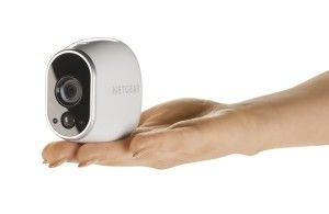 Arlo Smart Home Security Camera System on hand