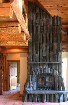 rough and rugged stone fireplace -- UGLY!  Looks like Barad Dur.