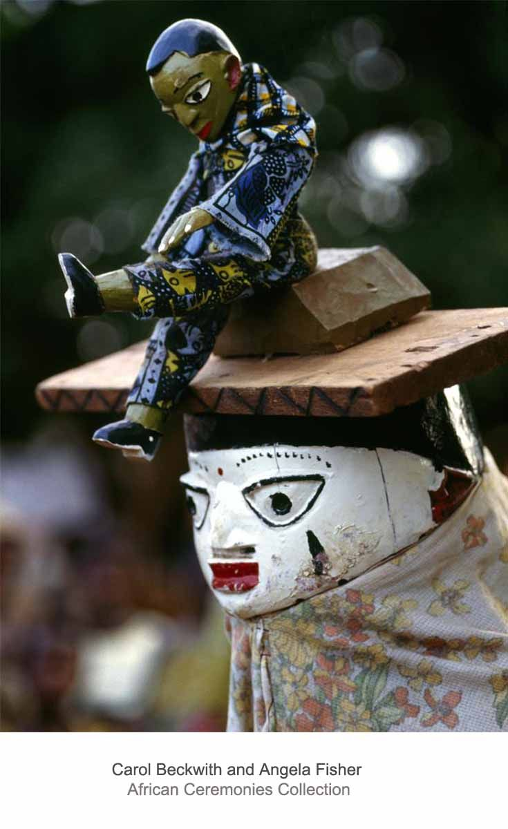 Africa | Awo mask performing at Yoruba Gelede masquerades; masks illustrate well-known cautionary Yoruba proverbs.  Benin. | ©Carol Beckwith and Angela Fisher