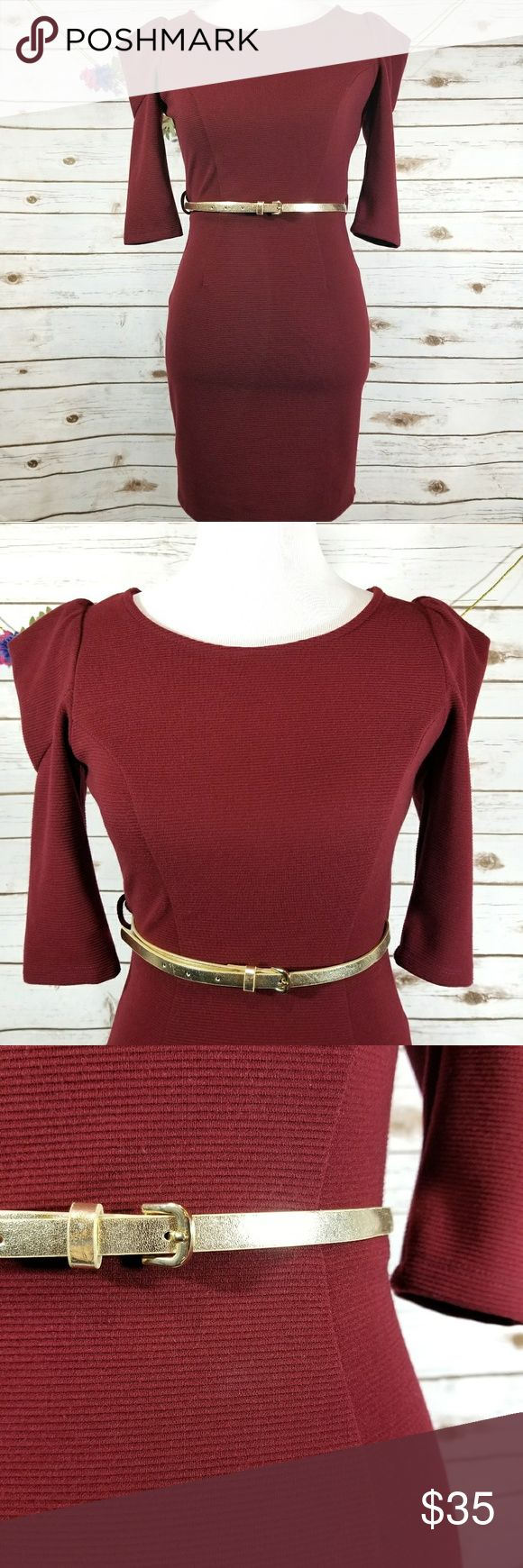 "Apricot Lane boutique burgundy dress This burgundy dress has 3/4"" sleeves. The dress fits tight and zips up the back (zipper is approx 17.5""). Length from the top of the shoulder to the bottom is approx 31.5"", bust is approx 32"". All measurements taken unstretched. 94% polyester, 6% spandex. Please note: the gold belt did not come with the dress but I am including it in the listing. The belt is a size s/m from forever 21 and is approx 39.5"". Apricot Lane Dresses Mini"