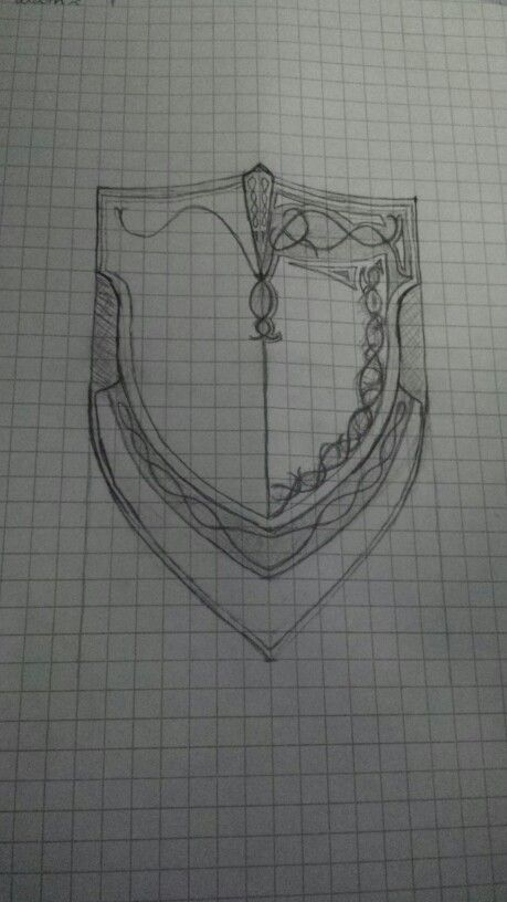 Progress: Waiting for the puffy paint to dry, I started sketching the shield and design details. Hoping to use it for a template later.