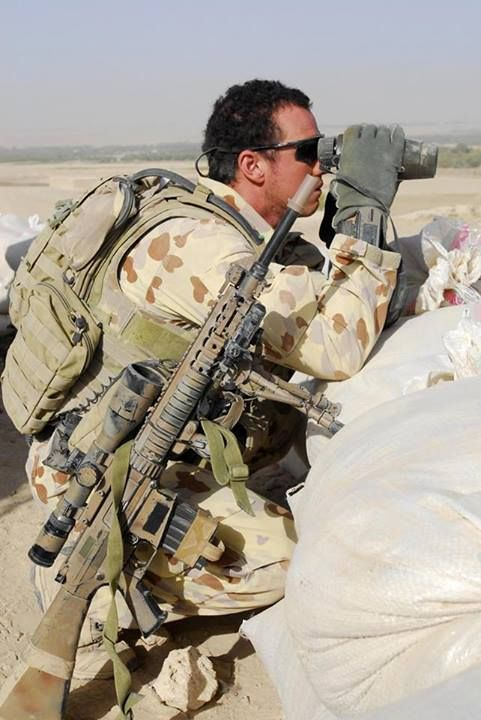 An Australian Army sniper carrying his SR-25 semi automatic sniper system in Afghanistan.
