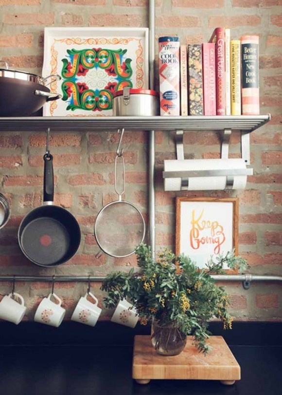 multiple layers of hanging items and of course love the brick wall kitchen