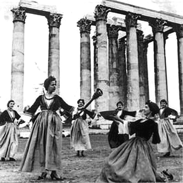 1956 ~ The ceremony of the Lighting of the Olympic Flame in the temple of Olympian Zeus in Athens