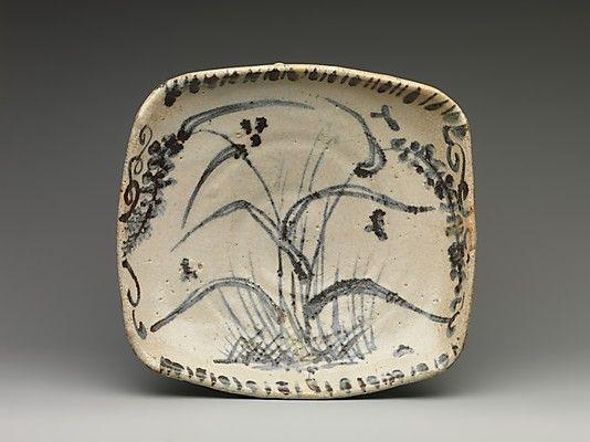 Dish with Reed Design  Period: Momoyama period (1573–1615) Culture: Japan Medium: Stoneware with underglaze iron decoration (Mino ware, Shino style) Dimensions: H. 2 1/4 in. (5.7 cm); W. 10 1/2 in. (26.7 cm); D. 9 3/4 in. (24.8 cm) Classification: Ceramic