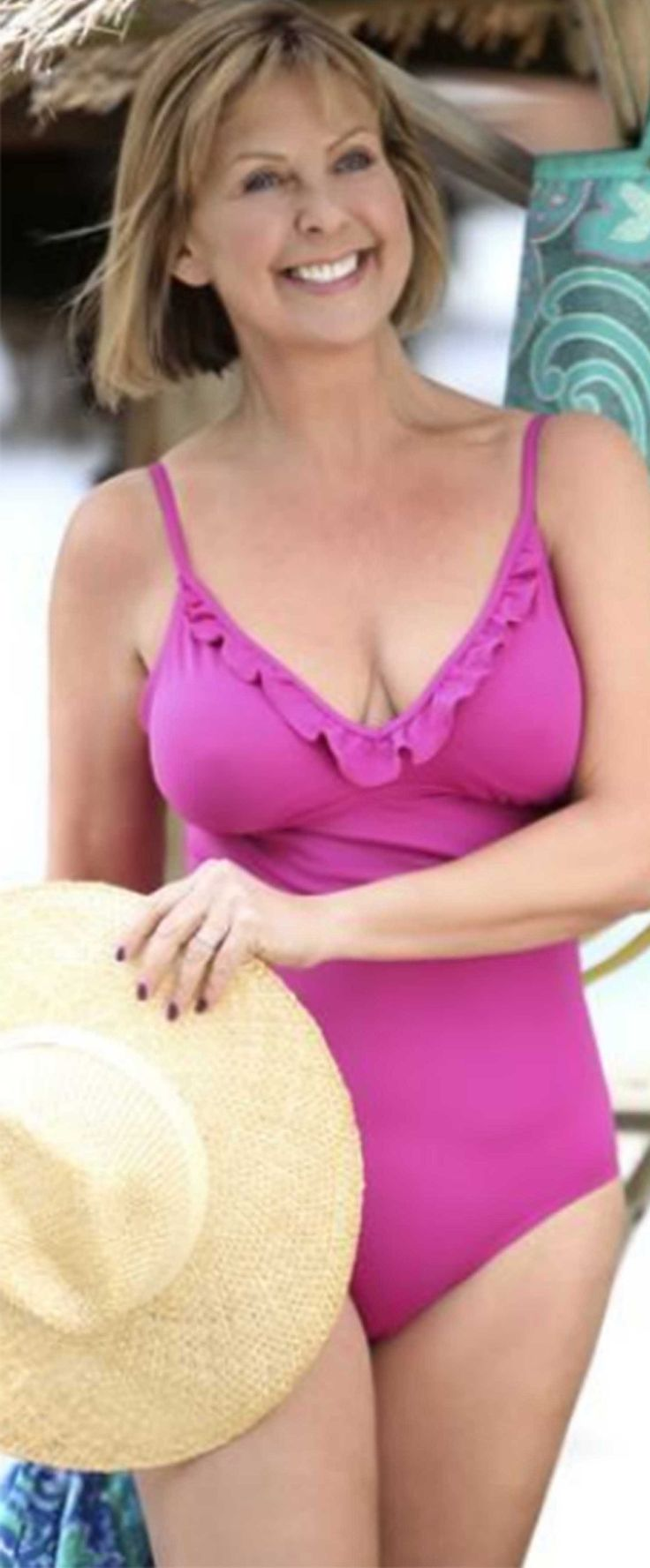 Lovely mature with great body strips for your pleasure 2