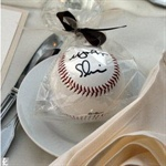 """baseball with the guests name """"signed"""" on it for a place setting . . . so cute for the sports enthusiast!"""