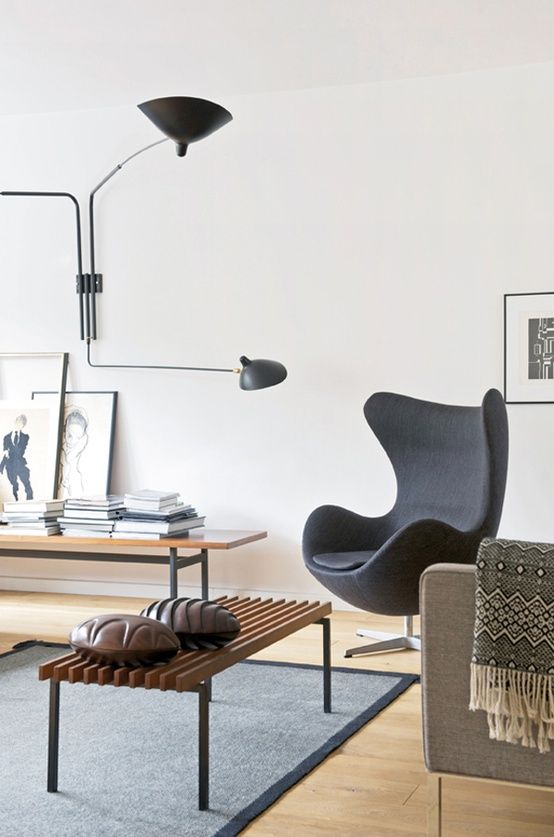 Beautiful Modern Living Room With Serge Mouille Wall Lamp