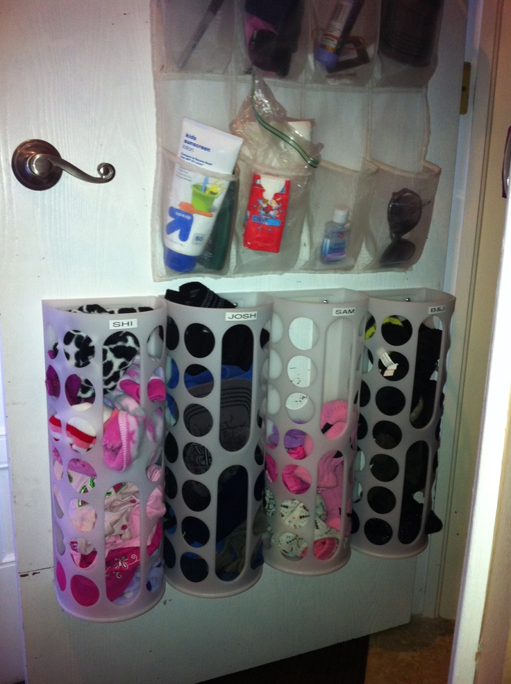 Coat Closet Organization... hanging pockets, and IKEA bag holders for gloves, hats, etc!