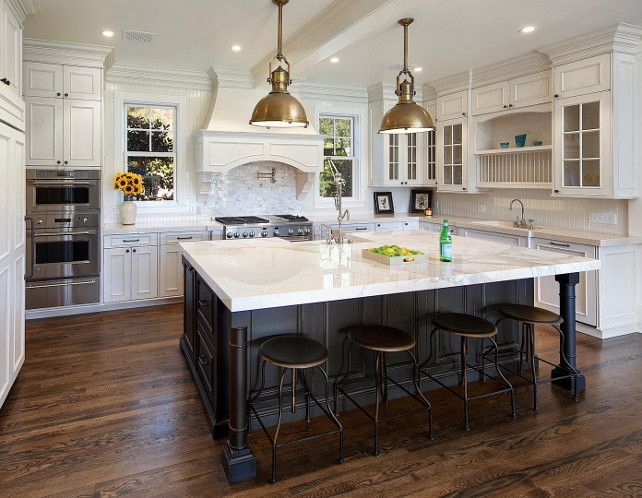 Linen White Benjamin Moore Kitchen. Kitchen. Off-white kitchen. Creamy white kitchen. Ivory kitchen cabinet with black island, marble countertop and oak wood flooring. Kitchen Pendants are the LARGE COUNTRY INDUSTRIAL PENDANT WITH METAL SHADE.
