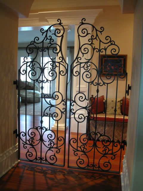 Iron gates inside of the house? Love this! Going into Daniels man cave.. Or my library?! Dreaming big.
