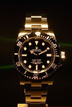 Rolex Oyster Perpetual Submariner No date.  Gold with Black bezel and Dial.  114060.