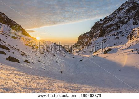 Sunrise in the mountains in winter  - stock photo
