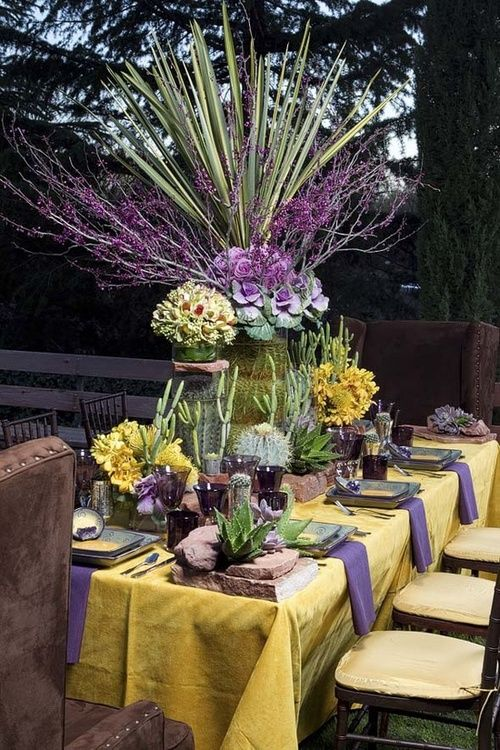 purple and yellow floral arrangement with yucca and cabbages