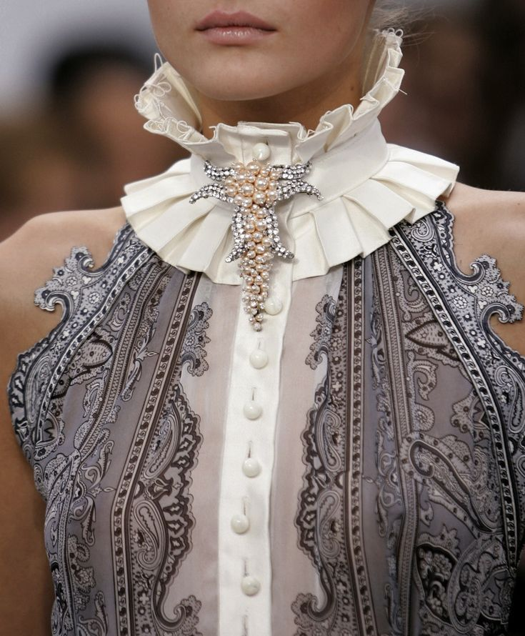 Jennikenns says: Perfact scale and choice of centrepiece.  Each to replicate with vintage pins of cascading pearls Balenciaga SS 06